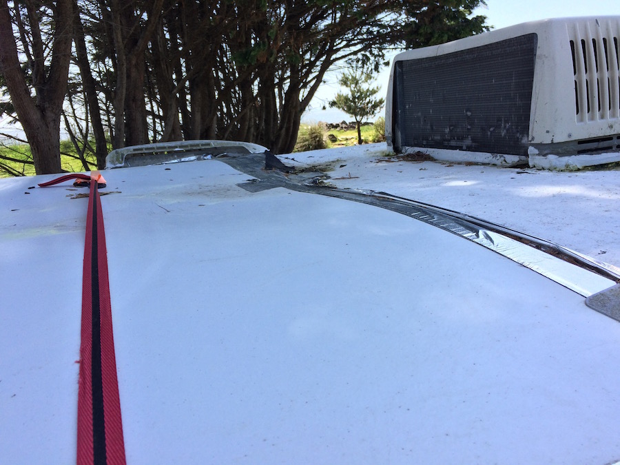 Temporary RV roof patch with panel
