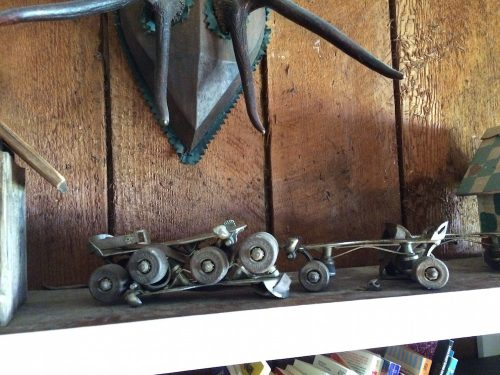 Old style roller skates on a shelf