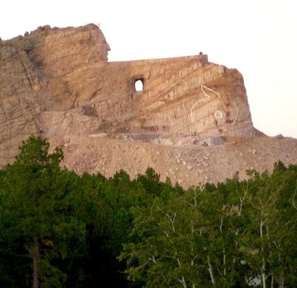 Crazy Horse Memorial as it appeared in 2010. The white outline is where the horse's head and eye will be. This is a massive sculpture. Nearby Mt. Rushmore is 59' tall. The nostril of the horse on the Crazy Horse Memorial is 26' in diameter. All of the funding for this memorial has been private. No government funds have been used.