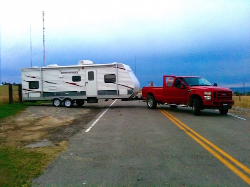 RV'ing 101 at the dealership did not cover this skill. This photo is taken standing at the closed gate. Truck is pointing about 11 o'clock and trailer back end is at about 4 o'clock.